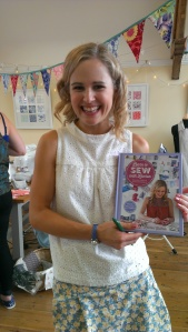 "Lauren Guthrie with her new book, ""Learn to Sew with Lauren"""