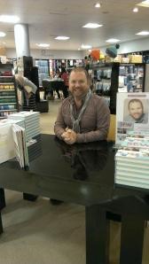 "Stuart Hillard ready to sign his book ""Sew Fabulous"""