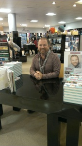 "Stuart Hillard ready to sign his book ""Sew Fabulous"""