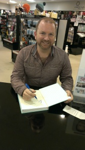 Stuart signs my book