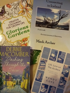 Three books and a colouring book