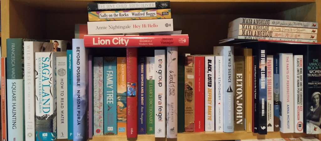 Row of books on a shelf, filling the shelf